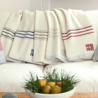Swans Island Co. GraceThrows. Handwoven in Maine with classic striped borders. Soft organic merino wool throw.
