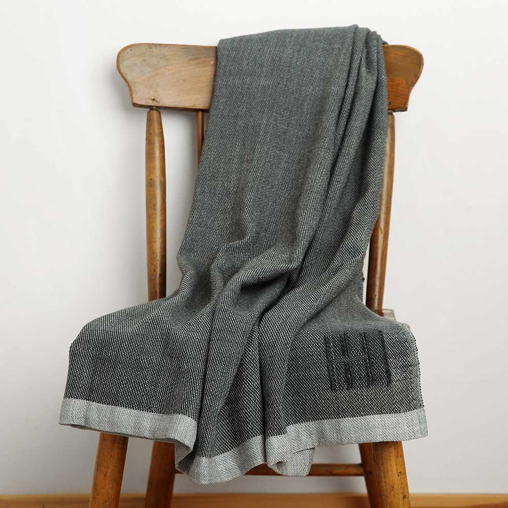 Swans Island's Katahdin throw in charcoal, organic merino wool, hand-dyed with all natural dyes