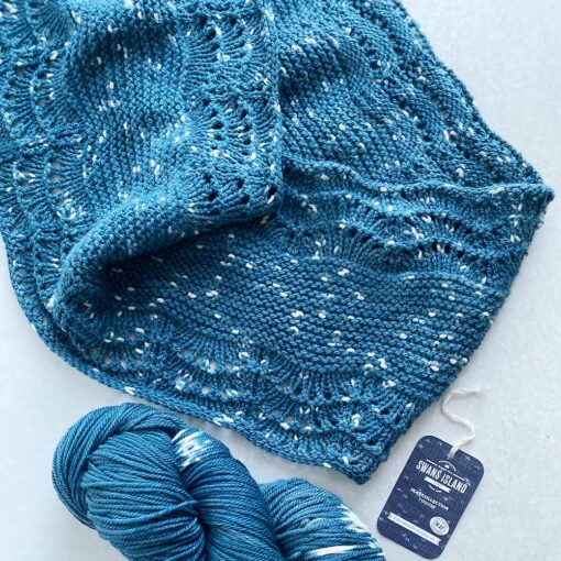 Swans Island's Anna Cowl knitting pattern shown in Firefly worsted weight organic merino hand-dyed yarn, Blue Spruce color.