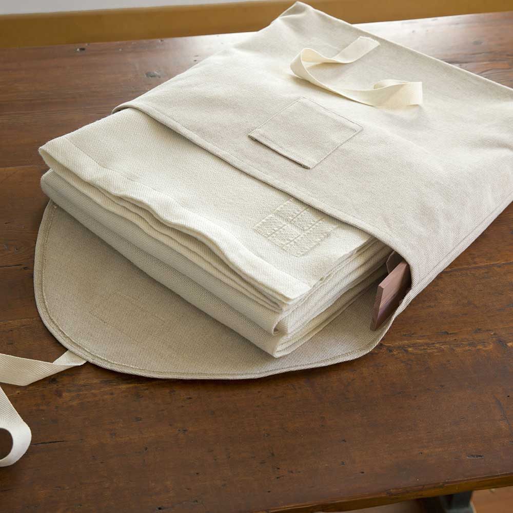 Swans Island handwoven blankets come in our custom linen storage bag with aromatic cedar slats.