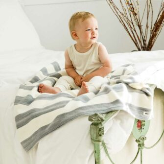 Swans-Island's_Regatta-Baby-Blanket in Pewter_-and Natural stripes is woven with soft organic Merino wool and cotton