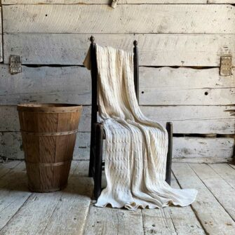 The Swans-Island_Cotton-Cabled-Throw_is knit in the USA with undyed natural cotton - soft, timeless, classic cables