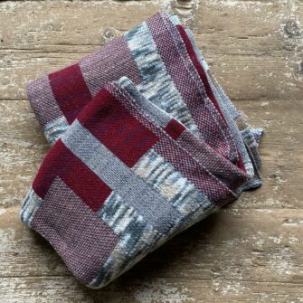 Swans-Island_Artisan-Patchwork-Throw-#1_in burgundy, birch and heathered grey