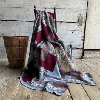 Swans-Island_Artisan-Patchwork-Throw-#1_in burgundy, birch and heathered grey.