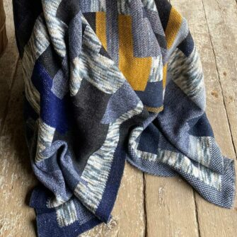 Swans-Island_Artisan-Patchwork-Throw-#2-knit in Navy Birch Gold and Charcoal