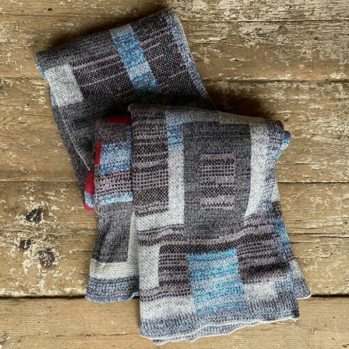 Swans Island Artisan Patchwork Throw #28 knit in USA with soft heathered taupes, browns and greys with patchwork blocks in richly marled blues, natural and burgundy tones.