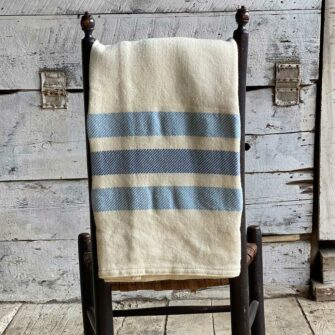 Swans-Island_Border-StripeThrow_in Natural with Light Blue/ Faded Indigo
