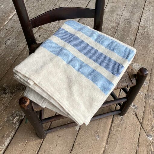 Swans-Island_Border-StripeThrow_100% wool woven in Maine. Natural with blue banded borders.
