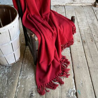 Swans Island's Summer Twill Throw in Rustic Red is woven from 100% cotton and made in USA.