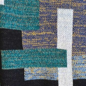 Swans Island Artisan Patchwork Throw #56 is knit in USA with soft, richly heathered and marled yarns.