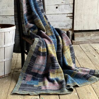 Artisan Patchwork Throw #57 is a one-of-a-kind knit, made in USA with richly marled yarns.