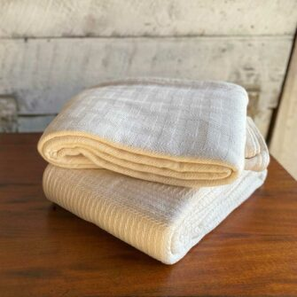 Swans Island Dover and Caroline Blankets - woven in undyed natural cotton have beautiful basketweave and cabled textures. Woven in Maine.