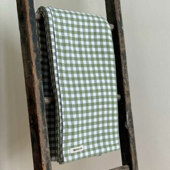 Swans Island's classic Gingham Check blanket is woven in Maine with 100% natural cotton.