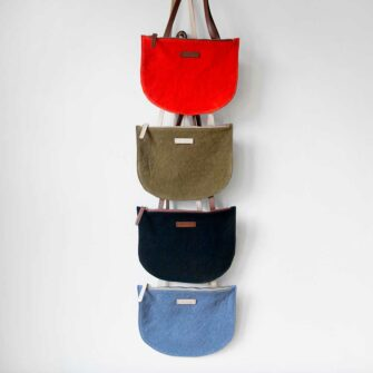Swans Island has the Seiken Crossbody By Graf Lantz. Cotton canvas bag with leather strap