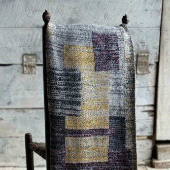 Swans Island's Artisan Patchwork Throw #81 is a one-of-a-kind knit. Made in USA this cozy oversized throw has richly marled yarns. Each one is unique.