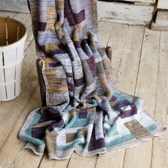 Swans Island's Artisan Patchwork Throw #107 is a one-of-a-kind knit.