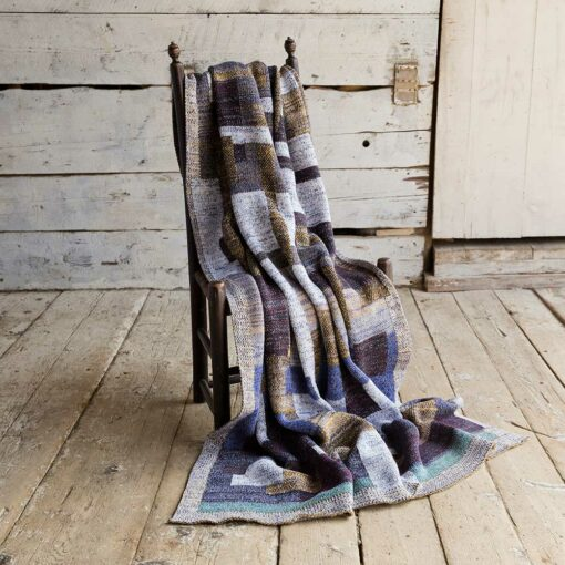 Swans Island's Artisan Patchwork Throw #108 is a one-of-a-kind knit.