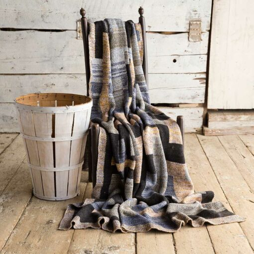 Swans Island's Artisan Patchwork Throw #110 is a one-of-a-kind knit.
