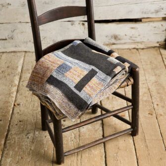 Swans Island's Artisan Patchwork Throw #113 is a one-of-a-kind knit.