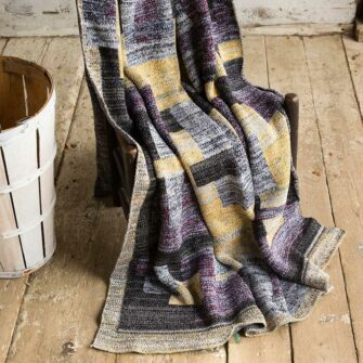 Swans Island's Artisan Patchwork Throw #115 is a one-of-a-kind knit.