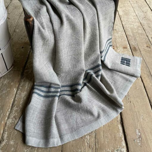 Swans Island Heritage Throw - handwoven in grey corriedale wool with teal stripes.