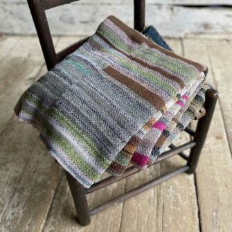 Artisan Ladders Throw #13 is a one-of-a-kind knit textile - a work of art! Made in USA.