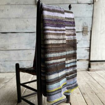 Artisan Ladders Throw #19 is a one-of-a-kind knit textile - a work of art! Made in USA.