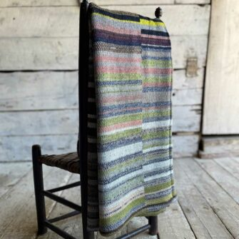 Artisan Ladders Throw #29 is a one-of-a-kind knit textile - a work of art! Made in USA.