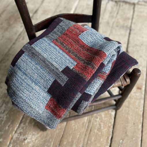 Swans Island's Artisan Patchwork Throw #201 is a one-of-a-kind knit. Made in USA this cozy oversized throw has richly marled yarns. Each one is unique.