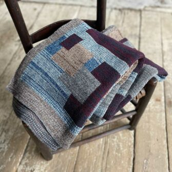 Swans Island's Artisan Patchwork Throw #203 is a one-of-a-kind knit. Made in USA this cozy oversized throw has richly marled yarns. Each one is unique.
