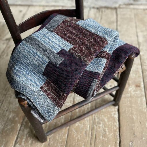 Swans Island's Artisan Patchwork Throw #204 is a one-of-a-kind knit. Made in USA this cozy oversized throw has richly marled yarns. Each one is unique.