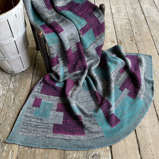 Swans Island's Artisan Patchwork Throw #205 is a one-of-a-kind knit. Made in USA this cozy oversized throw has richly marled yarns. Each one is unique.