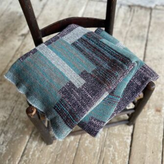 Swans Island's Artisan Patchwork Throw #206 is a one-of-a-kind knit. Made in USA this cozy oversized throw has richly marled yarns. Each one is unique.