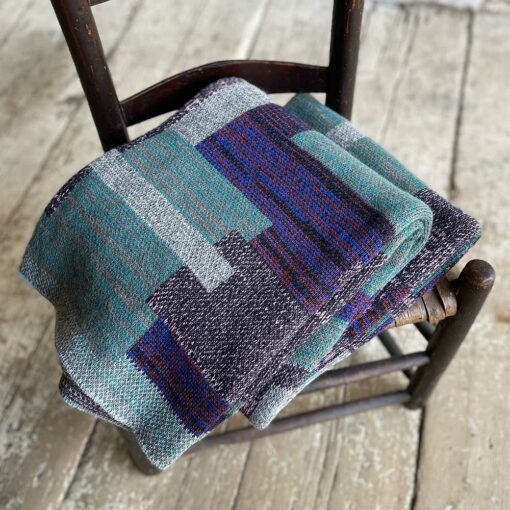 Swans Island's Artisan Patchwork Throw #207 is a one-of-a-kind knit. Made in USA this cozy oversized throw has richly marled yarns. Each one is unique.