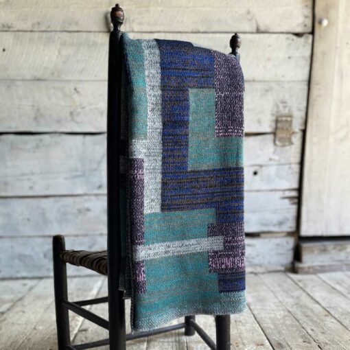 Swans Island's Artisan Patchwork Throw #209 is a one-of-a-kind knit. Made in USA this cozy oversized throw has richly marled yarns. Each one is unique.