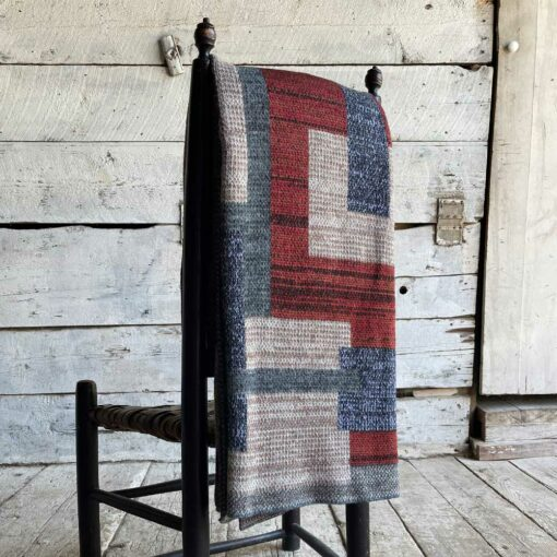 Swans Island's Artisan Patchwork Throw #211 is a one-of-a-kind knit. Made in USA this cozy oversized throw has richly marled yarns. Each one is unique.