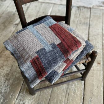 Swans Island's Artisan Patchwork Throw #212 is a one-of-a-kind knit. Made in USA this cozy oversized throw has richly marled yarns. Each one is unique.