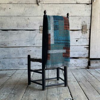 Swans Island's Artisan Patchwork Throw #214 is a one-of-a-kind knit. Made in USA this cozy oversized throw has richly marled yarns. Each one is unique.