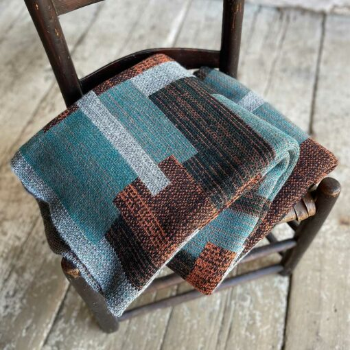 Swans Island's Artisan Patchwork Throw #215 is a one-of-a-kind knit. Made in USA this cozy oversized throw has richly marled yarns. Each one is unique.