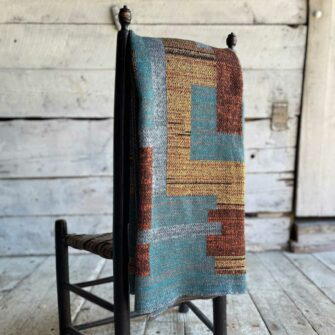 Swans Island's Artisan Patchwork Throw #216 is a one-of-a-kind knit. Made in USA this cozy oversized throw has richly marled yarns. Each one is unique.