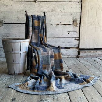 Swans Island's Artisan Patchwork Throw #217 is a one-of-a-kind knit. Made in USA this cozy oversized throw has richly marled yarns. Each one is unique.