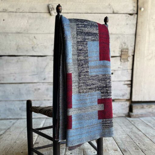 Swans Island's Artisan Patchwork Throw #218 is a one-of-a-kind knit. Made in USA this cozy oversized throw has richly marled yarns. Each one is unique.