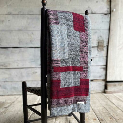 Swans Island's Artisan Patchwork Throw #221 is a one-of-a-kind knit. Made in USA this cozy oversized throw has richly marled yarns. Each one is unique.