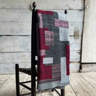 Swans Island's Artisan Patchwork Throw #222 is a one-of-a-kind knit. Made in USA this cozy oversized throw has richly marled yarns. Each one is unique.