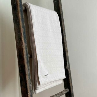 Swans Island's beautifully texured Bedford Blanket is woven in Maine in undyed natural cotton.