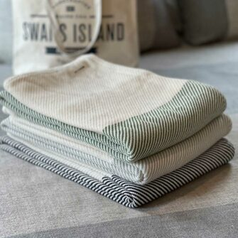 Swans Island's Everyday Cotton Throw blanket is woven in Maine with 100% American cotton.
