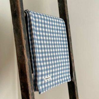 Swans Island's classic Gingham Check Throw blanket is woven in Maine with 100% natural cotton.