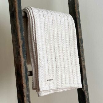 Swans Island's Heavy Cable Throw blanket is woven in Maine with 100% American cotton.