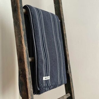 Swans Island's beautifully contrasting Pick Stripe Blanket is woven in Maine with soft, natural cotton.