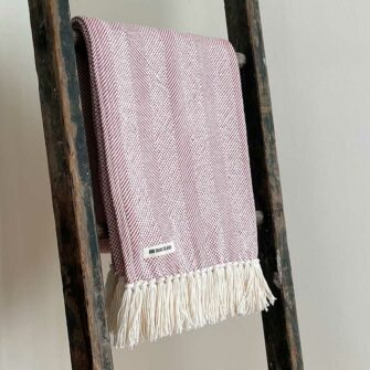 Swans Island's Savannah Throw blanket is woven in Maine with 100% American cotton and features a hand-tied fringe.